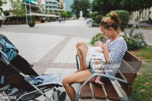 Mother breastfeeding her baby outdoor
