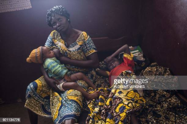 TOPSHOT A mother breathfeeds one of her children on February 14 as they wait for a doctor in the rest room at the maternity in Boali which has no...