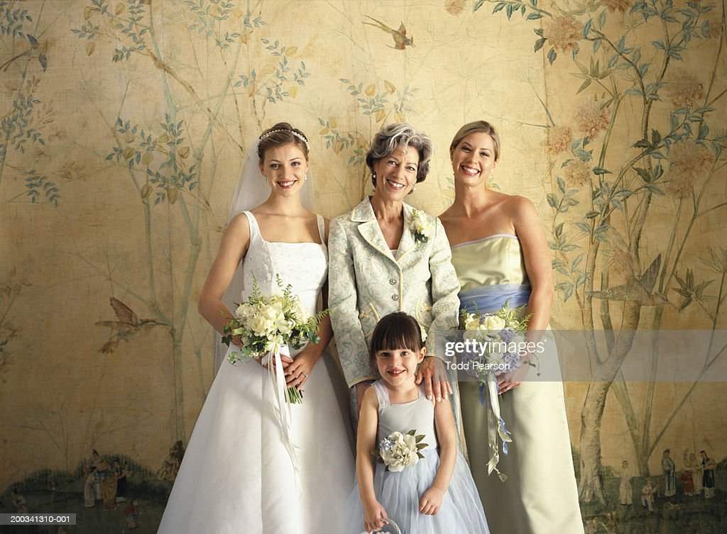 3b20b42cb44c Mother Bride Bridesmaid And Flower Girl Smiling Portrait Stock Photo ...