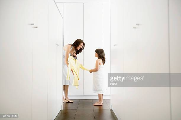 Mother Bringing Clothes for Her Daughter After a Bath