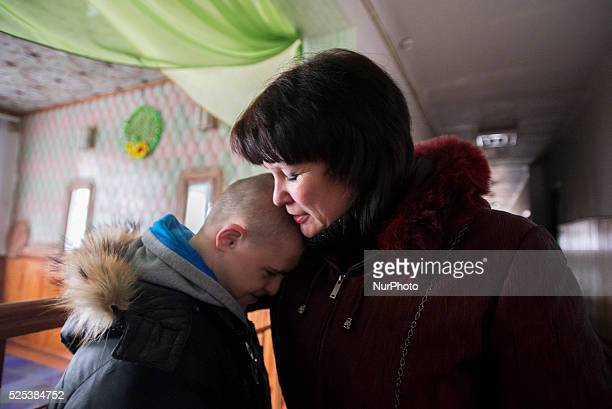 Mother bringing her son with Down's syndrome to boarding school after vacations Teterivka's Orphanage and Boarding school Zhytomyr Ukraine 2 of...
