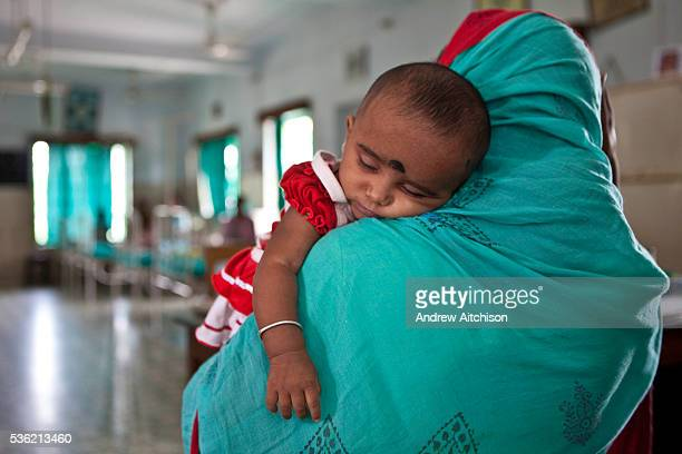 A mother brings her malnourished baby to the CINI emergency ward Care on the CINI ward includes medical intervention for the child and nutrition...