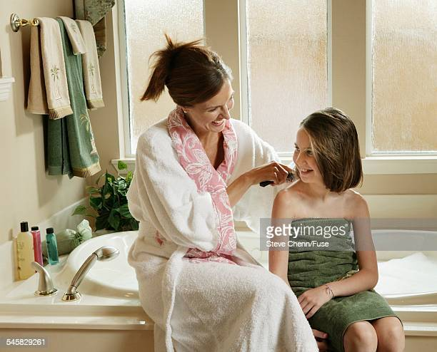 Mother Brushing Daughters Hair after Bath