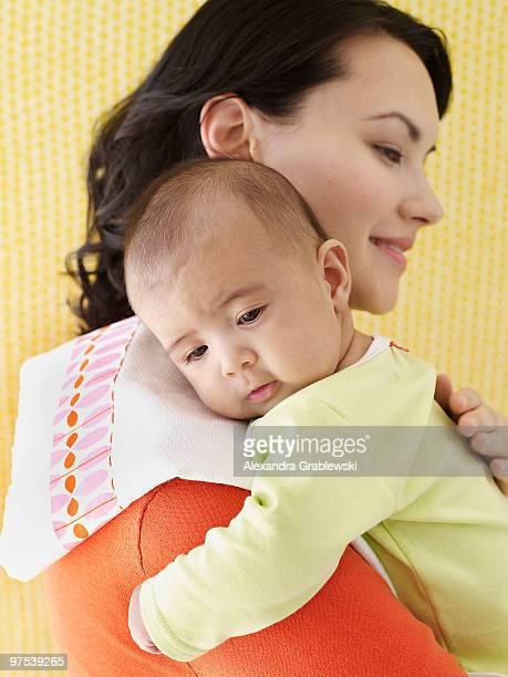 Mother Burping Baby
