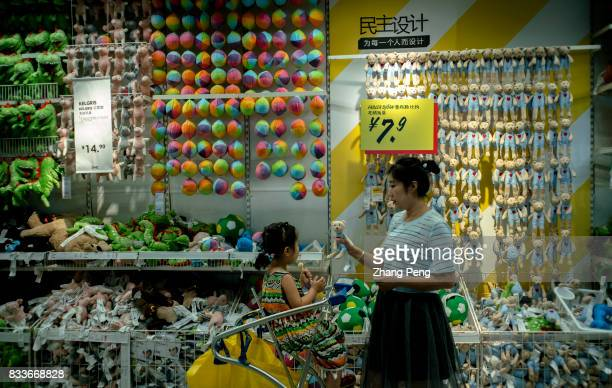 A mother buys toys for her daughter in an IKEA shop In 2016 the total sales of IKEA in China reached 125 billion yuan an increase of 189% and...