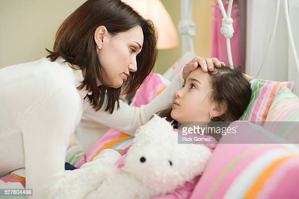 Mother Caring for Sick Daughter