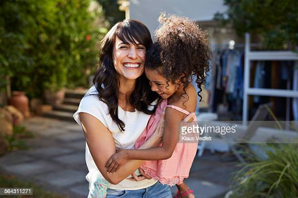 mother carrying daughter & both laughing - single mother stock pictures, royalty-free photos & images