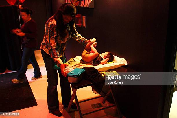 """Mother changing a baby's diaper at the Cileo club in New York City during the """"Baby Loves Disco"""" Party on Jan 13 2007. The monthly event is an..."""