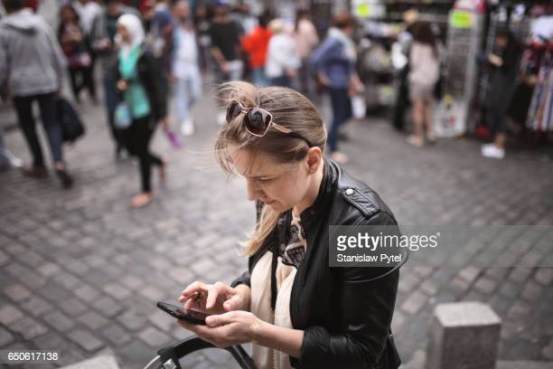 Mother checking her mobile device