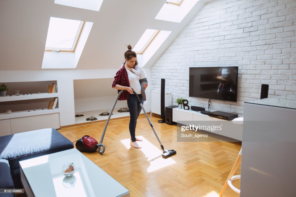 Mother Cleaning Living Room : Stock Photo