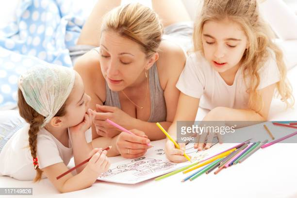 Mother Coloring With Her Children