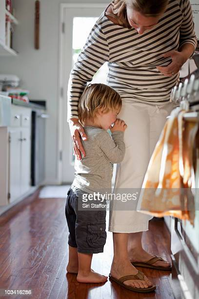 mother comforting crying young son, 2 years old - 2 3 years stock pictures, royalty-free photos & images