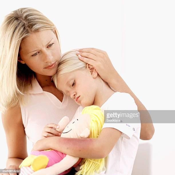 mother comforting her sick daughter (6-7)