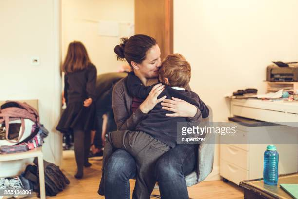 mother comforting kid - single mother stock pictures, royalty-free photos & images