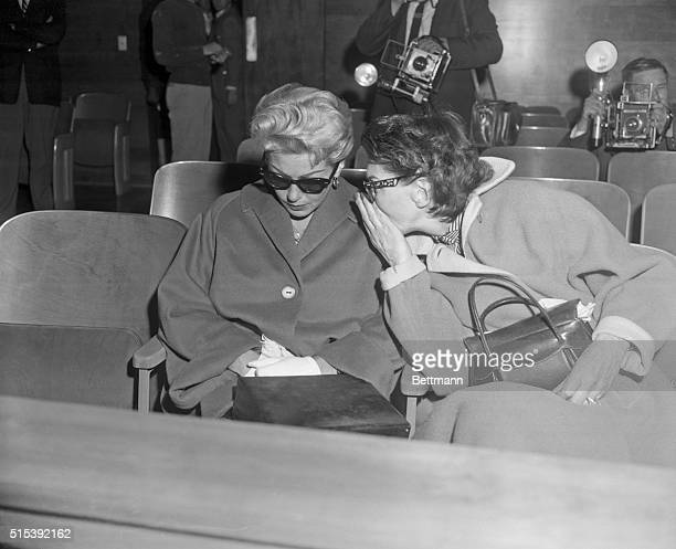Mother Consoles Lana at Hearing Los Angeles California Mrs Mildred Turner right leans over to comfort her daughter actress Lana Turner who was on the...