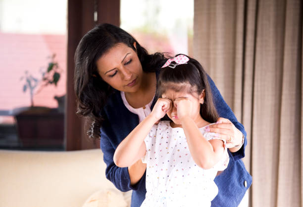 mother consoling crying daughter - asian woman hugging a crying woman stock pictures, royalty-free photos & images