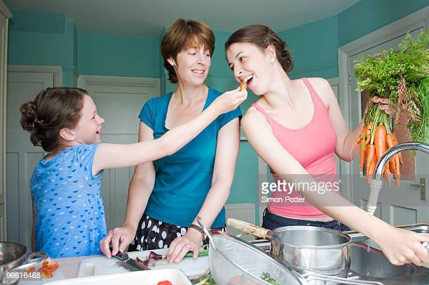 Mother cooking with her two daughters