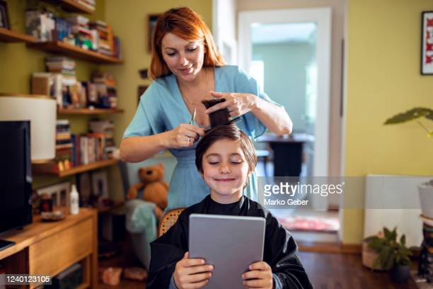 mother cutting sons hair at home - cutting stock pictures, royalty-free photos & images