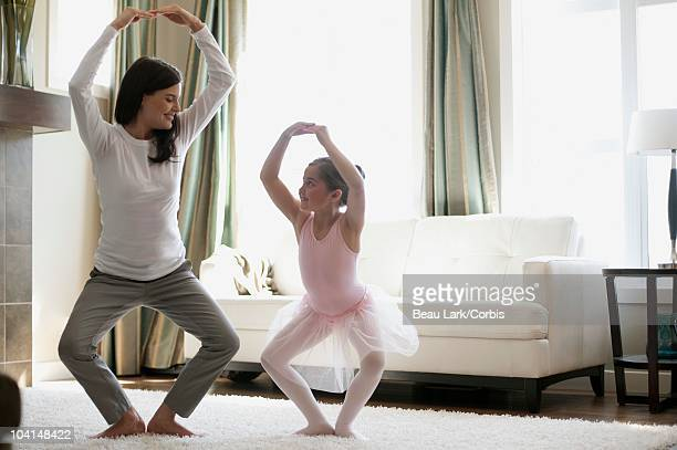 Mother dancing with daughter