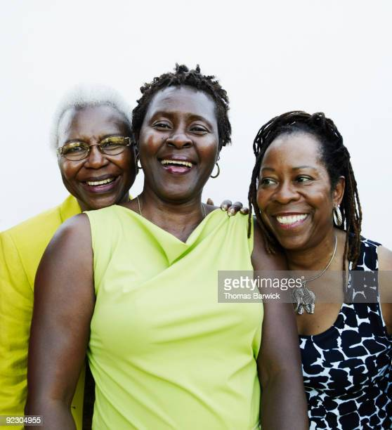 mother daughter and friend smiling and laughing - two generation family stock photos and pictures