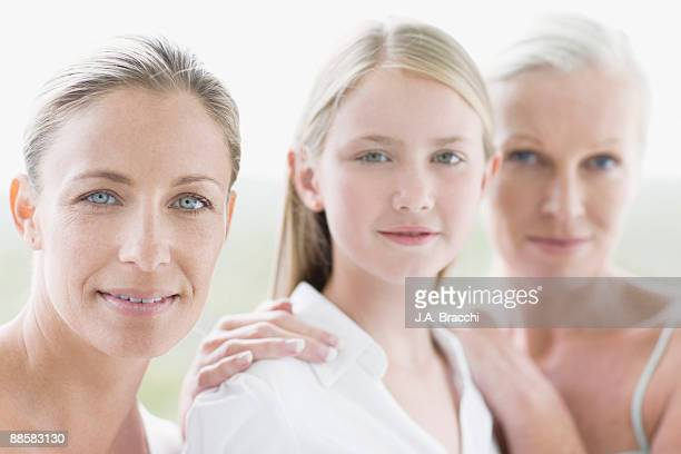 Mother, daughter and grandmother posing