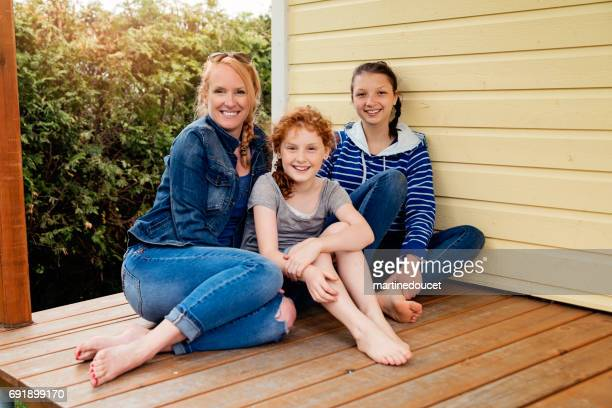 mother, daughter and niece family portrait at country home. - niece stock photos and pictures