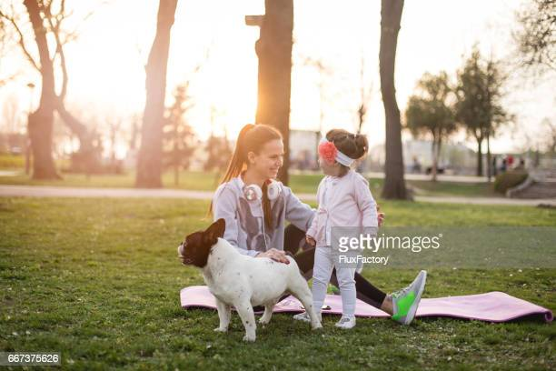 Mother , daughter and their pet French bulldog