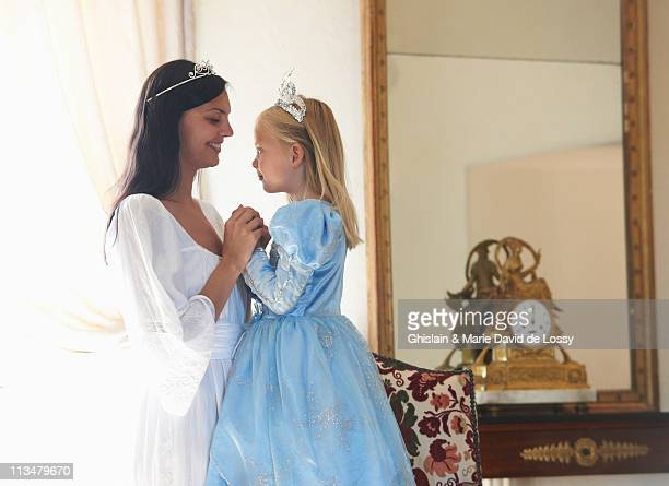 mother & daughter dressed as princesses - princess stock pictures, royalty-free photos & images