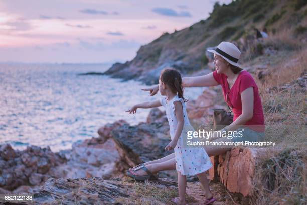 Mother & daughter enjoying together before the sunset