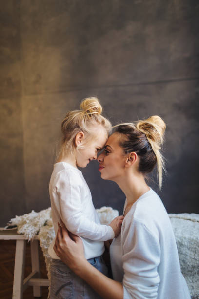 mother daughter moments - mom and daughter stock pictures, royalty-free photos & images