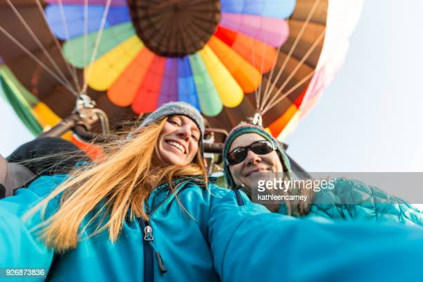 mother daughter on a hot air balloon flight - hot air balloon stock pictures, royalty-free photos & images