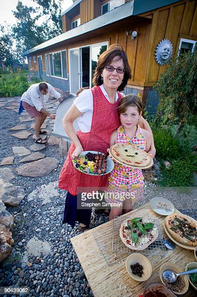 mother & daughter, outdoor barbecue, pizza making