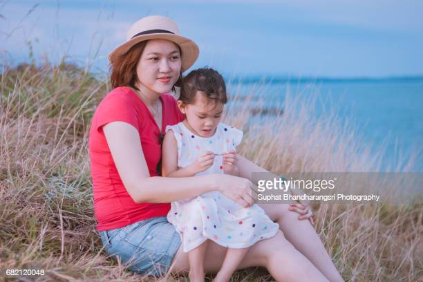 Mother & daughter picnic at the hill side