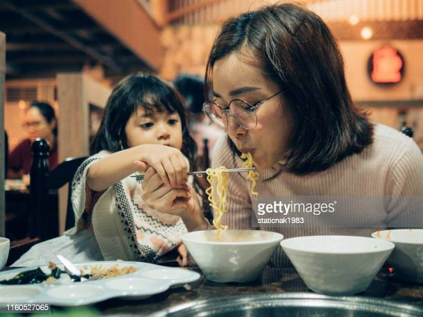 mother daughter - korean culture stock pictures, royalty-free photos & images