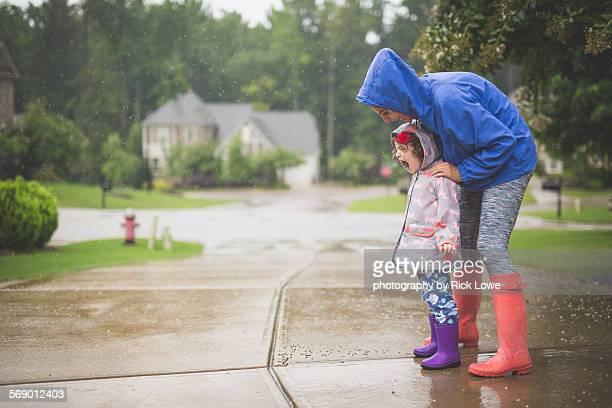Mother daughter playing the da rain