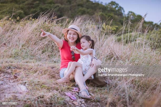 Mother & daughter relaxing at the hill