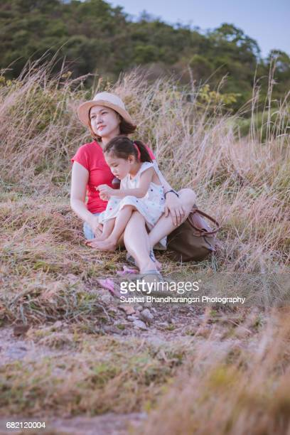 Mother & daughter take a rest at the hill