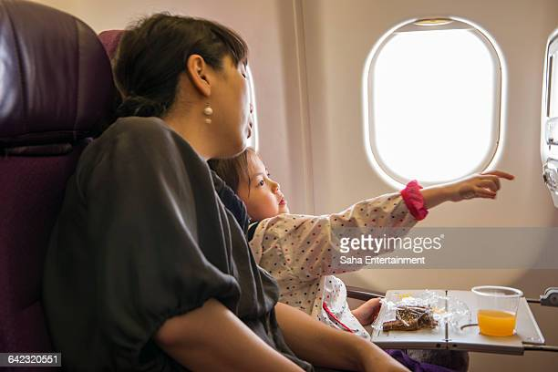 Mother & Daughter watching Movie on the Airplane