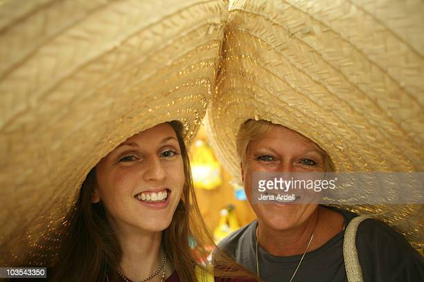 Mother & daughter wearing large Mexican sombreros