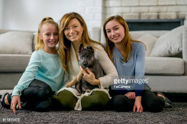 Mother, Daughters, And Puppy