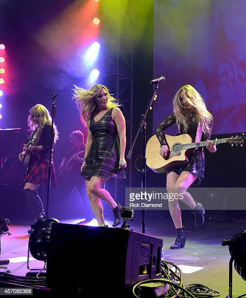 Mother Daughters Country Trio Lucy Angel L/R Kate Anderton Lindsay Anderton and Emily Anderton perform at Atlantis Paradise Island on October 11 2014...