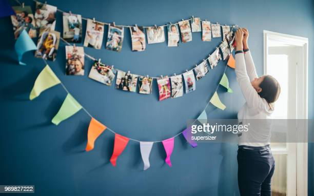 mother decorating for birthday - printout stock pictures, royalty-free photos & images