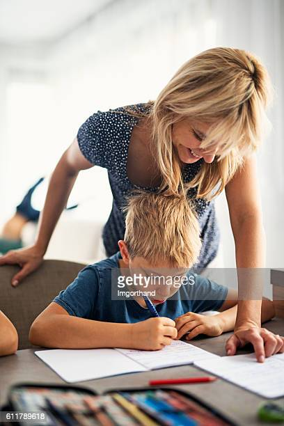 Mother doing homework with her son.