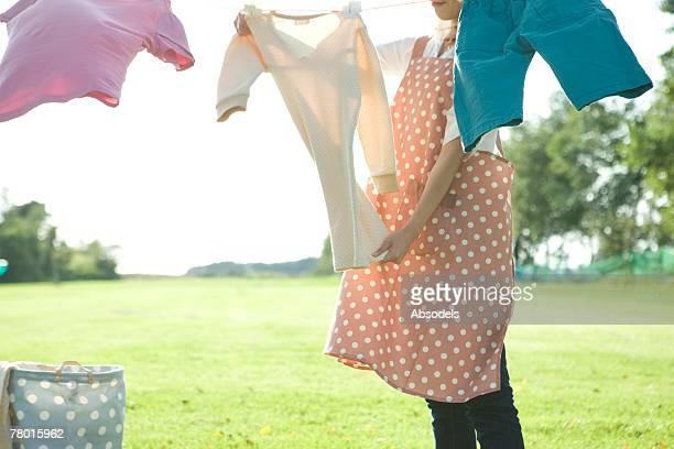 Mother doing Landry outside