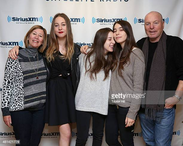 Mother Donna Haim sisters Este Alana and Danielle Haim of HAIM and father Mordechai Haim visit the SiriusXM Studios on November 22 2013 in New York...