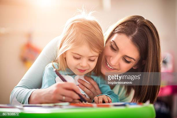 Mother drawing with her daughter