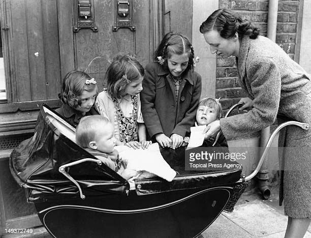 A mother draws her family allowance at Vicarage Lane Post Office East Ham London 6th August 1946