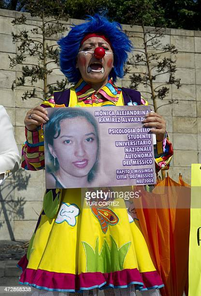 A mother dressed as clown takes part in a protest during the Mother's Day commemoration in Mexico City on May 10 2015 Hundreds of mothers and...