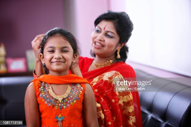 Mother Dressing Up Daughter