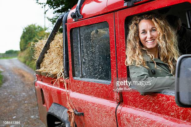 mother driving 4x4 on the farm - devon stock pictures, royalty-free photos & images